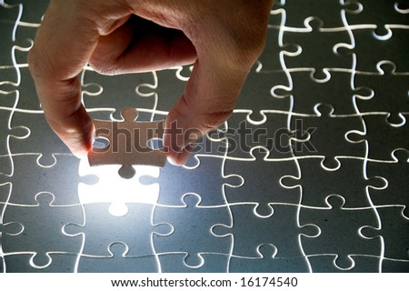 collection of puzzle pieces compositions with backlighting - stock photo