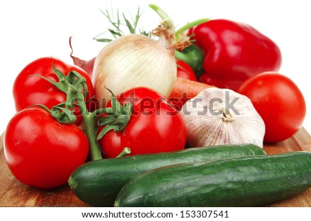 collection of raw vegetables on kitchen wooden board isolated over white background - stock photo