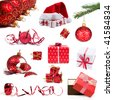 Collection of red Christmas decorations and gifts on white background - stock photo