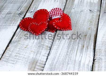Collection of red hearts on white painted rustic antique wooden background; Valentine's Day and love concept - stock photo