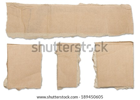 collection of ripped  brown pieces of cardboard, shadows, isolated on white. - stock photo