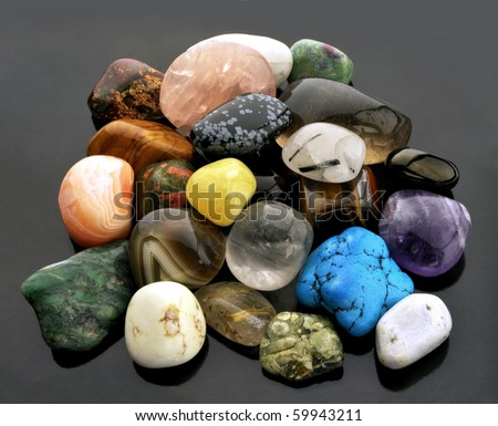 Collection of semi-precious gemstones, isolated on neutral grey background - stock photo