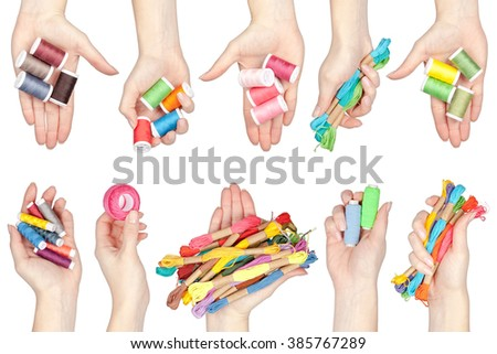 collection of sewing and embroidery threads in a hands isolated on white background - stock photo