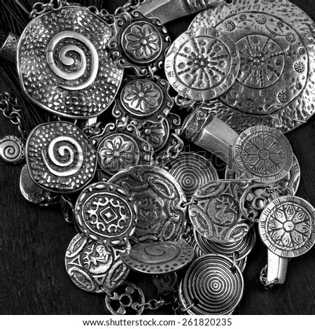 Collection of silver ethnic jewelry. - stock photo