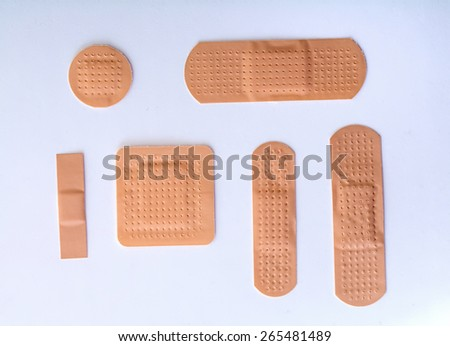 collection of six different bandages on white background - stock photo