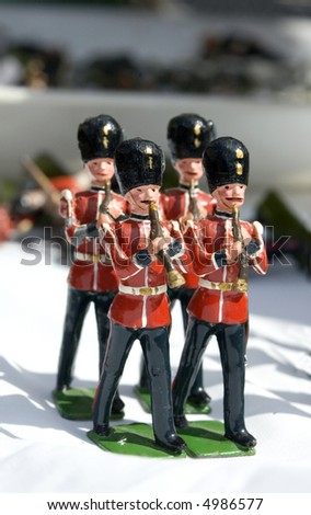 Collection of small toy figurines of typical English soldier marching band - stock photo