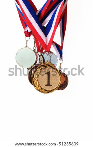 Collection of sports medals on a wall on a white background - stock photo
