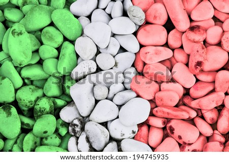 collection of stones with the colors of the Italian flag - stock photo