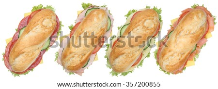 Collection of sub deli sandwiches baguettes in a row with salami, ham and cheese top view isolated on a white background - stock photo