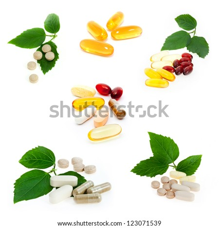 Collection of supplements on white background - stock photo