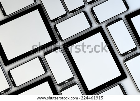 collection of tablets and smartphones with blank screens - stock photo