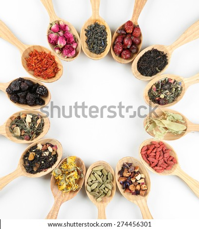 Collection of tea and natural additives in wooden spoons, isolated on white  - stock photo