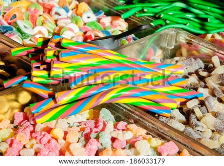 Collection of the colorful gummy and marshmellow candies at market. - stock photo