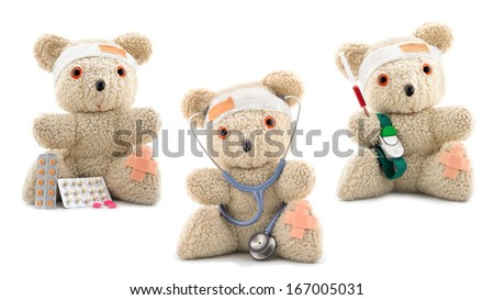 Collection of three doctor bears wearing bandages, isolated on white - stock photo