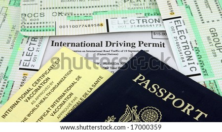 Collection of Travel Documents - Passport, International Driving Permit, International Vaccination Certificate and Airline Boarding Passes. - stock photo