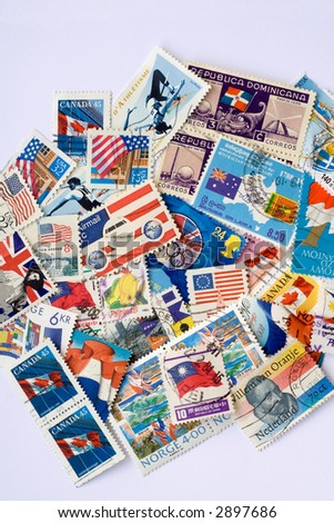 Collection of used postage stamps with flags.