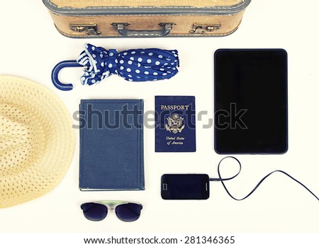 Collection of vacation travel items with a vintage filter - stock photo