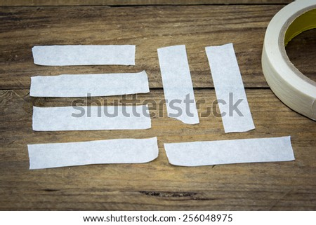 collection of various adhesive tape pieces on wood background.  - stock photo