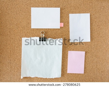 collection of various blank note paper on cork board