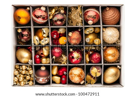 Collection of various Christmas decorations, placed into cardboard box with dividers - stock photo