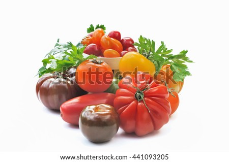 collection of various colorful tomatoes on white background - stock photo
