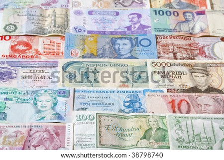 collection of various currencies from countries around the world - stock photo