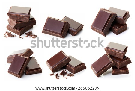 Collection of various dark chocolate pieces isolated on white background