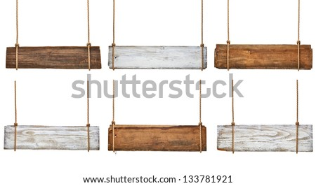 collection of various empty wooden signs hanging on a rope on white background. each one is shot separately - stock photo