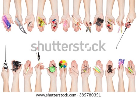 collection of various fishing tackle in a hands isolated on white background - stock photo