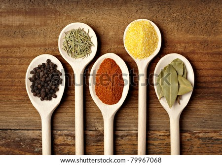collection of various food ingredients in wooden spoons - stock photo
