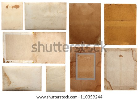 Collection of various grunge paper pieces, isolated on white background.