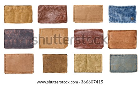 collection of various jeans labels on white background. each one is shot separately. - stock photo