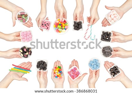 collection of various jelly candies in a hands isolated on white background - stock photo
