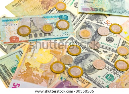 Collection of various money to background. Isolated on white. - stock photo