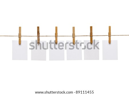 collection of  various notes and a clothes pegs on white background with clipping path - stock photo