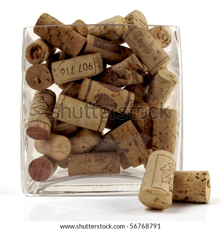 Collection of various old wine bottle corks in a glass vase - stock photo