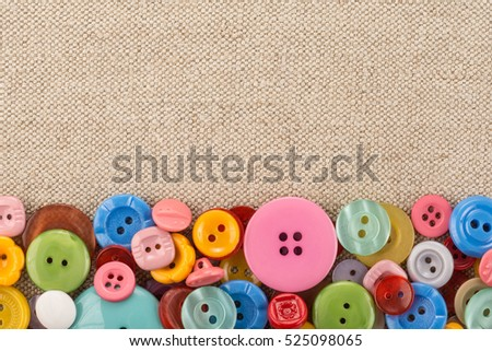 Collection of various sewing buttons on fabric background