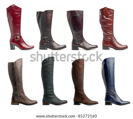 Collection of various types of knee high boots over white - stock photo