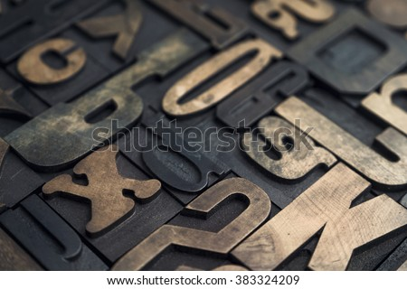 Collection of various wood type letters for printing with selective focus - stock photo