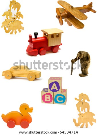 Collection of vintage and homemade wooden toys on white background. - stock photo