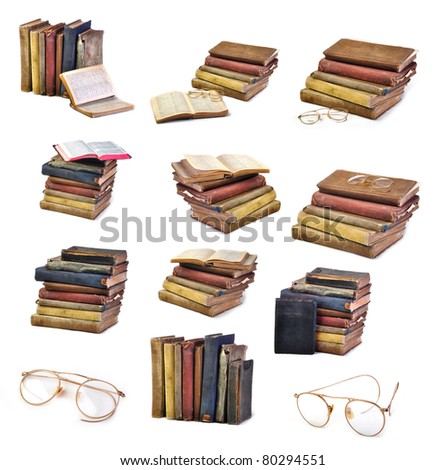 Collection of Vintage antique books and glasses isolated on white - stock photo