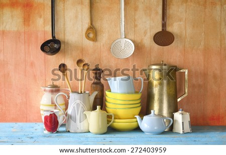collection of vintage dishes and kitchen utensils - stock photo