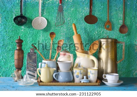 collection of vintage kitchenware, green background  - stock photo