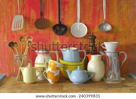 collection of vintage kitchenware, red background  - stock photo