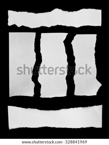 collection of white ripped pieces of paper on black - stock photo