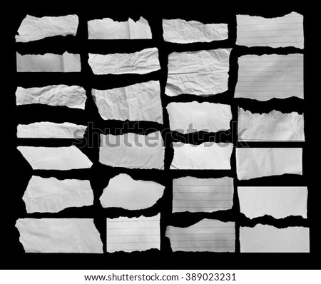 collection of white ripped pieces of paper on black
