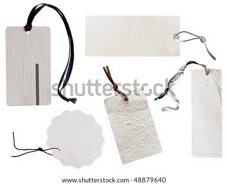 collection of white tags with dark string - stock photo