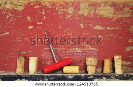 collection of wine corks and a corkscrew, free copy space - stock photo