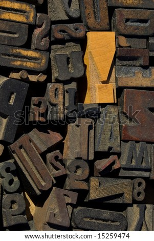 collection of wood type blocks with an emphasis on an exclamation point - stock photo