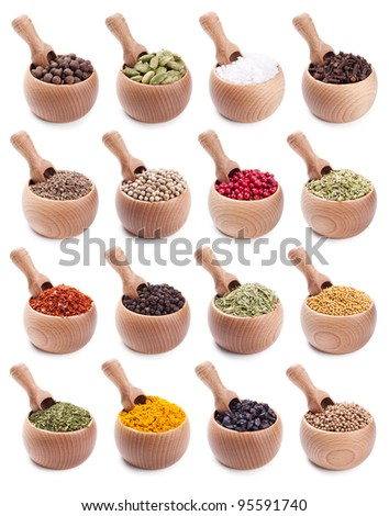 collection of wooden bowls full of different spices with scoops in it - stock photo